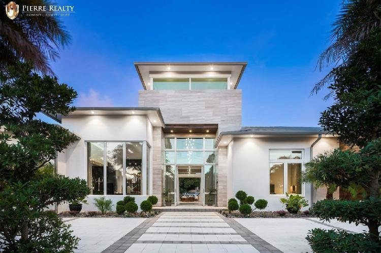 Spectacular Seven Isles single story waterfront estate